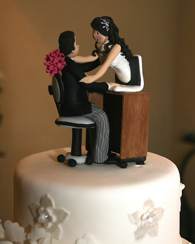 Interracial wedding cake decoration stock photo